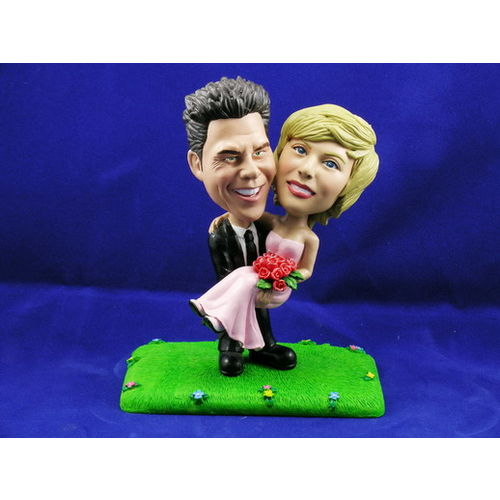 Bobblehead-standing-on-grass-carrying-the-bride