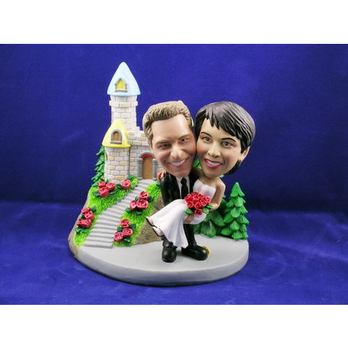 Bobblehead-carrying-the-bride-before-a-castle-wedding-gift