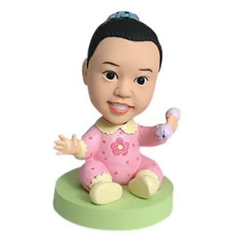 Photo of Baby Girl With Rattle Bobblehead