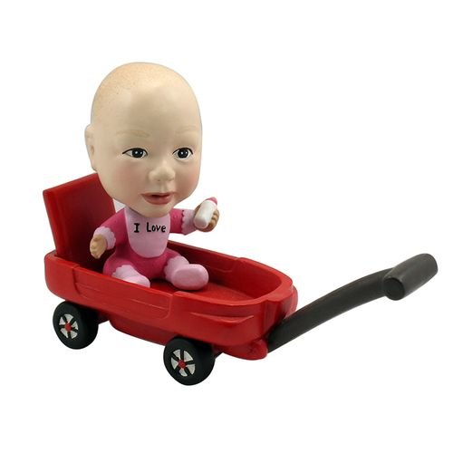 Photo of Baby In A Wagon Bobblehead