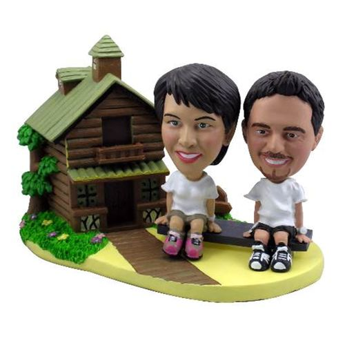 Photo of Couple On Seesaw Outside A Log Cabin Bobblehead