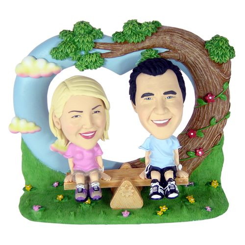 Photo 1 of Couple On Seesaw Under A Tree Bobblehead