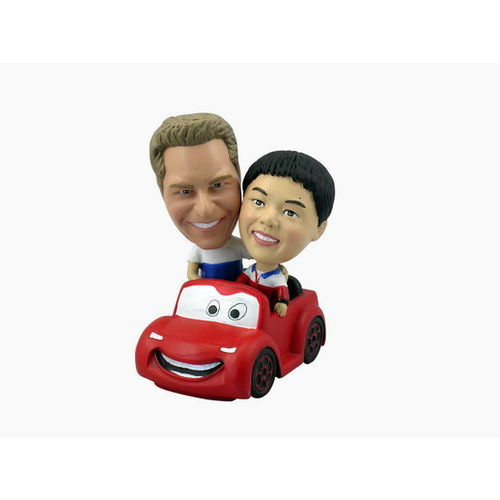 Couple_20in_20red_20car_20with_20face