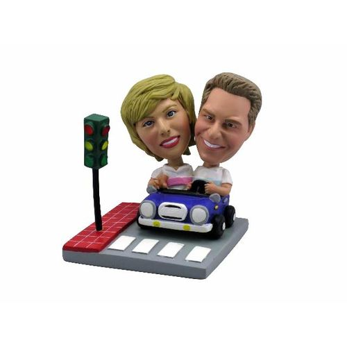 Couple-in-blue-car-at-stoplight