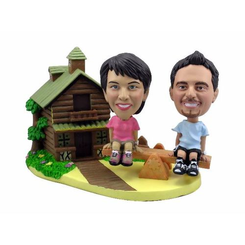 Photo 1 of Couple On Seesaw With Log Cabin Bobblehead