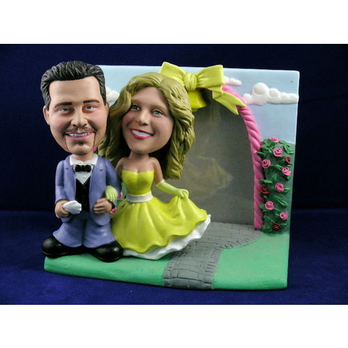 Photo 1 of Bride and Groom In Classic Pose With Rose Garden Frame Bobblehead