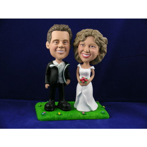Photo 1 of Bride and Groom On Lawn With Flowers Bobblehead