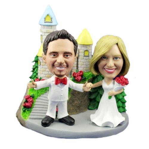 Photo 1 of Bride and Groom With Arms Outstretched At Castle Bobblehead