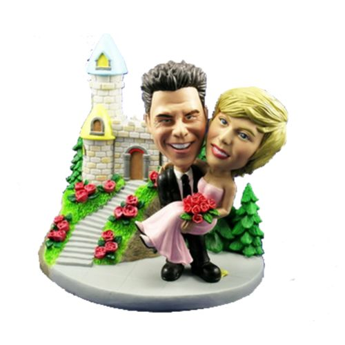 Photo of Groom Carries Bride At Castle Bobblehead