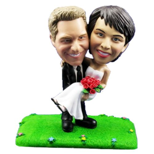 Photo of Groom Carries Bride On Lawn Bobblehead
