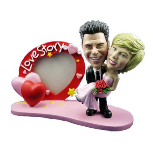 Photo of Groom Carries Bride With Heart Frame Bobblehead