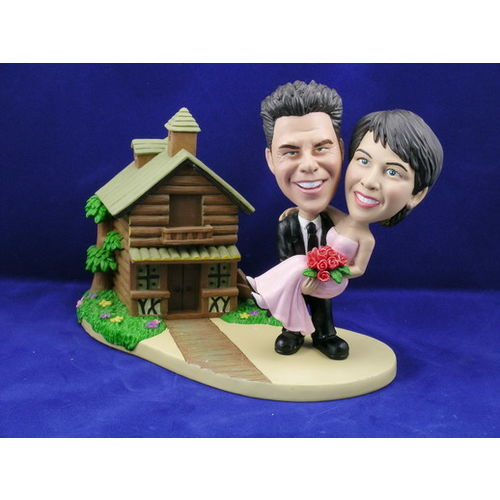 Groom-carrying-bride-with-log-cabin