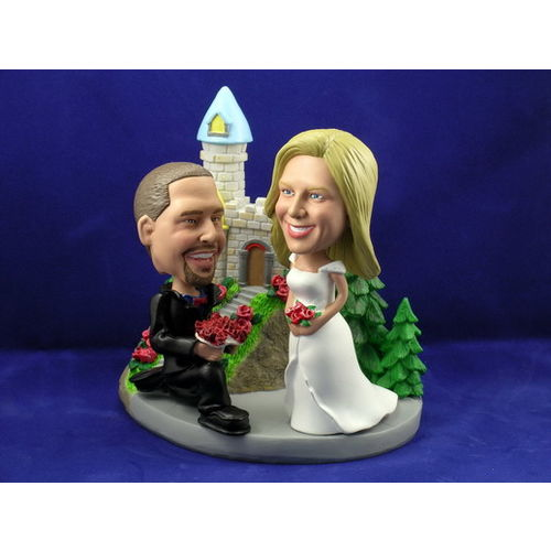 Photo 1 of Groom On Bended Knee With Bride At Castle Bobblehead