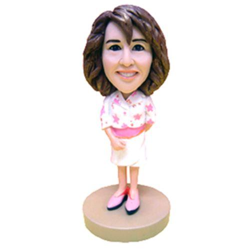 Photo 1 of Woman In White & Pink Blazer Bobblehead
