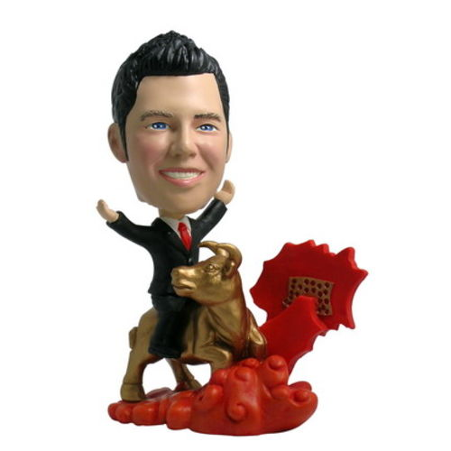 Photo of Man Riding Golden Bull Bobblehead