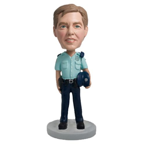 Photo 1 of Police Officer Holding Hat Bobblehead