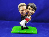 Groom Carries Bride On Lawn Bobblehead - Bobbleheads.com