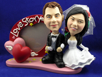 Bride and Groom With Heart Frame Bobblehead - Bobbleheads.com
