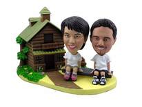 Couple On Seesaw Outside A Log Cabin Bobblehead - Bobbleheads.com