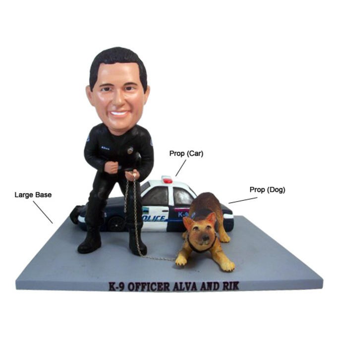 Example custom bobblehead with car prop, dog prop, and large base.